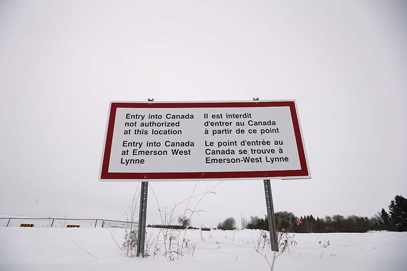 A sign is seen near Emerson, Man. Thursday, February 9, 2016. Refugees have been crossing the closed border port into Canada at Emerson and authorities had a town hall meeting in Emerson to discuss their options. (John Woods/CP)