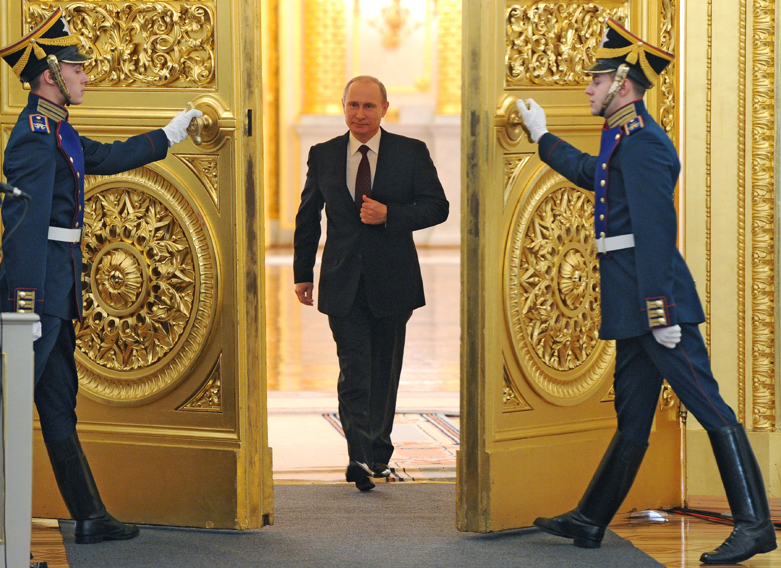 Russian President Vladimir Putin enters the St. George Hall at the Grand Kremlin Palace at the Kremlin in Moscow, on December 12, 2013, to deliver an annual state of the nation address. (Mikhail Klimentyev/AFP/Getty Images)