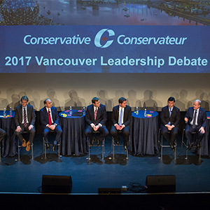 Conservative Party leader candidates, from left, Lisa Raitt, member of parliament (MP), Andrew Saxton, former member of parliament (MP), Chris Alexander, former minister of immigration, Rick Peterson, venture capitalist, Brad Trost, member of parliament (MP), Andrew Scheer, member of parliament (MP), Michael Chong, member of parliament (MP), Erin O'Toole, member of parliament (MP), and Steven Blaney, former minister of public safety, participate in the Conservative Party of Canada leadership debate in Vancouver, British Columbia, Canada, on Sunday, Feb. 19, 2017. (Ben Nelms/Bloomberg via Getty Images)