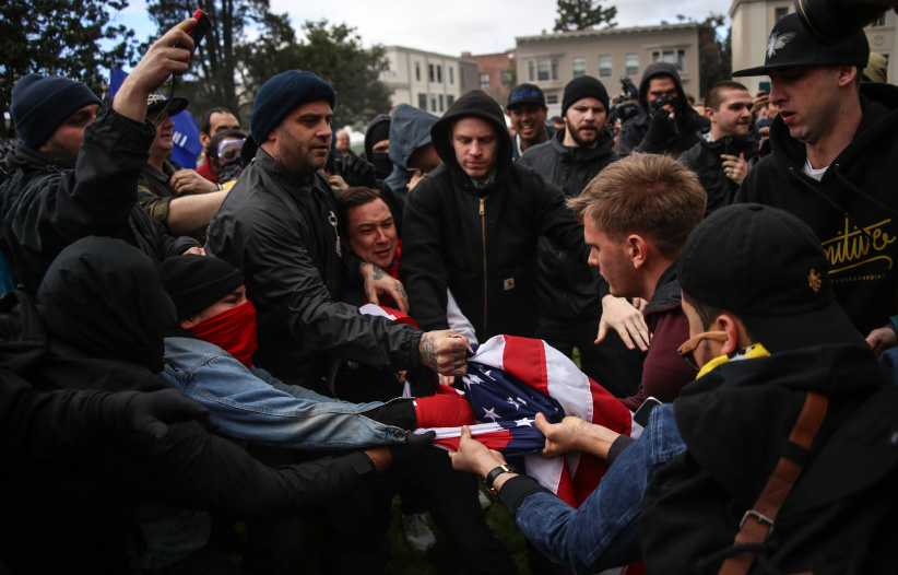 Anti-Trump protestors and the supporters of U.S. President Donald Trump battle over an American flag after violence broke out during a free speech rally in Berkeley, United States on March 4, 2017. (Joel Angel Juarez/Anadolu Agency/Getty Images)