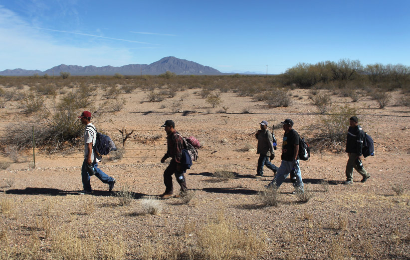 Undocumented Mexican immigrants walk through the Sonoran Desert after illegally crossing the U.S.-Mexico border border on January 19, 2011 into the Tohono O'odham Nation, Arizona. The immigrants said they had wandered the desert lost for a week after crossing from Mexico into the vast Indian reservation at night. Exhausted, they requested the Border Patrol to pick them up and take them to the U.S.-Mexico border, from where they would return to their homes in the Mexican state of Sonora. They had come, they said, to reach Phoenix and find work in construction or landscaping. All said they had worked in Arizona before. (John Moore/Getty Images)