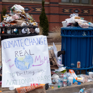 A placard warning against the dangers of climate change used in the March on Washington stands by an overflowing garbage can January 21st 2017, up to 500,000 marchers had protested earlier in DC and estimates of five million nationwide campaigned for legislation and policies regarding human rights, women's rights, immigration reform, healthcare reform, the natural environment, LGBTQ rights, racial equality and freedom of religion in response to the newly elected presidency of Donald Trump. (Epics/Getty Images)