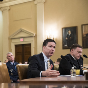 WASHINGTON, DC - MARCH 20: ( L to R) James Comey, Director of the Federal Bureau of Investigation (FBI), and Michael Rogers, Director of the National Security Agency, testify during a House Permanent Select Committee on Intelligence hearing concerning Russian meddling in the 2016 United States election, on Capitol Hill, March 20, 2017 in Washington. While both the Senate and House Intelligence committees have received private intelligence briefings in recent months, Monday's hearing is the first public hearing on alleged Russian attempts to interfere in the 2016 election. (Drew Angerer/Getty Images)