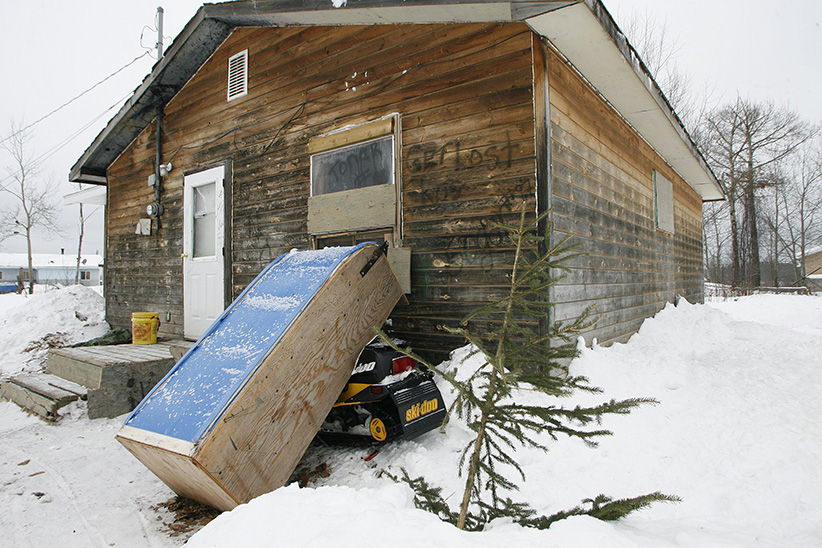 The outside of Pikangikum First Nation resident Juliette Turtle's home, Friday, January 5, 2007. Pikangikum First Nation is a remote-access community located on Pikangikum Lake, approximately 100 km northwest of Red Lake, Ont. Half of the 430 homes are falling apart and unfit to live in, yet continue to be occupied. Ninety per cent don't have running water or indoor toilets. (John Woods/CP)