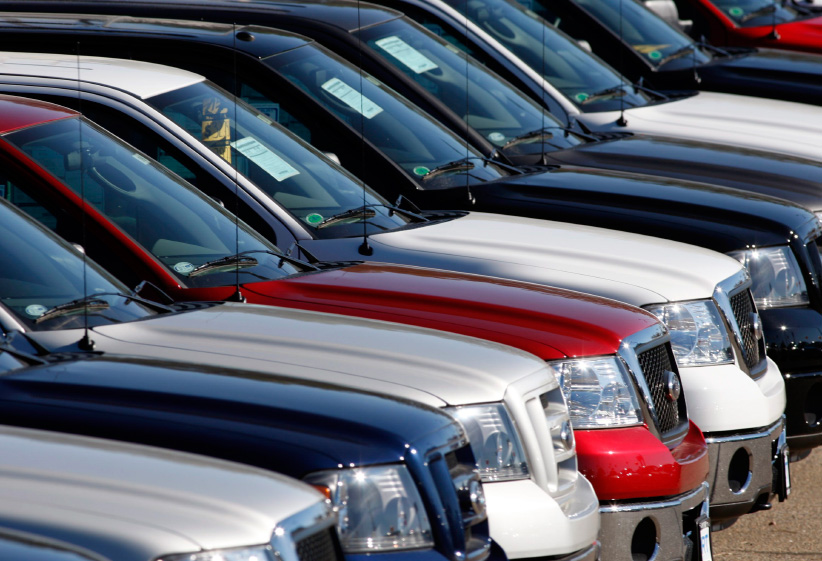 F-150 pickup trucks on the lot at a Ford dealership. (David Zalubowski/AP/CP)