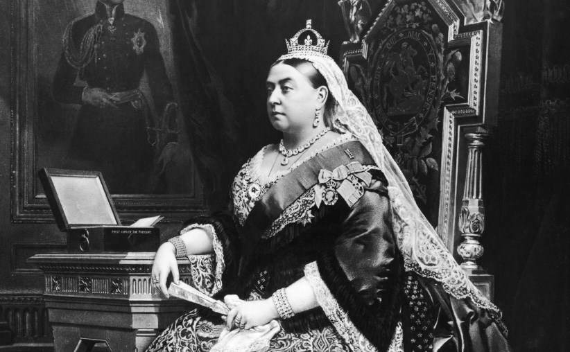 An 1883 painting of Queen Victoria (1819 - 1901), taken from an 1882 photograph by Alexander Bassano. Behind the queen is a portrait of her deceased consort, Prince Albert, by German artist Franz Xaver Winterhalter, and the box beside her is labelled 'First Lord of the Treasury'. (Hulton Archive/Getty Images)