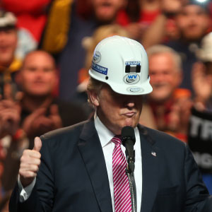 Republican Presidential candidate Donald Trump models a hard hat in support of the miners during his rally at the Charleston Civic Center on May 5, 2016 in Charleston, West Virginia. Trump became the Republican presumptive nominee following his landslide win in indiana on Tuesday. (Mark Lyons/Getty Images)