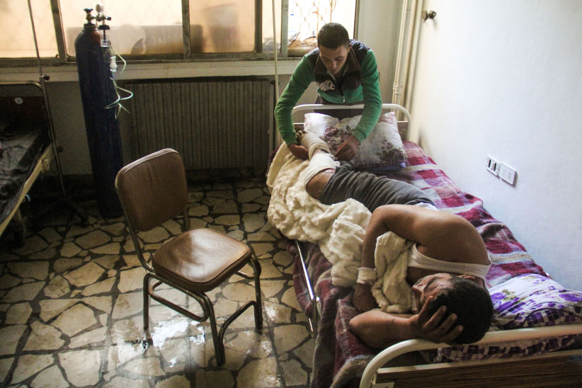 A picture taken on April 6, 2017 shows 40-year-old Hassan Youssef, a victim of the April 4, 2017 suspected toxic gas attack in Khan Sheikhun, receiving medical care in a hospital in the nearby northwestern Syrian city of Idlib. (Omar Haj Kadour/AFP/Getty Images)