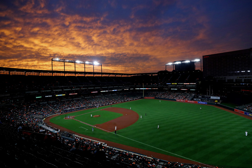 The sun sets during the game between the Toronto Blue Jays and the Baltimore Orioles at Oriole Park at Camden Yards on Wednesday, April 5, 2017 in Baltimore Maryland. (Alex Trautwig/MLB Photos/Getty Images)