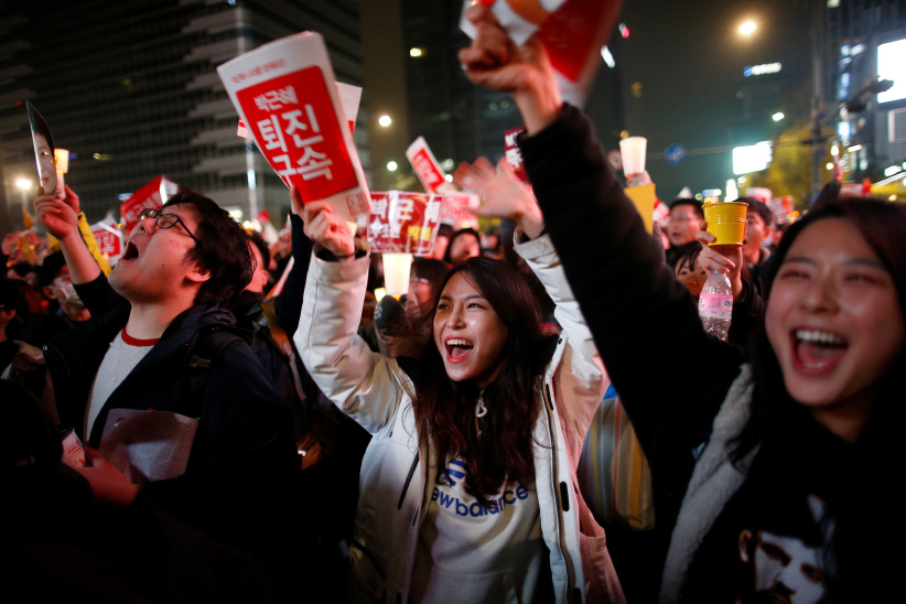 People chant slogans as they march toward the Presidential Blue House during a protest calling South Korean President Park Geun-hye to step down in Seoul, South Korea, November 19, 2016. (Kim Hong-Ji/Reuters)