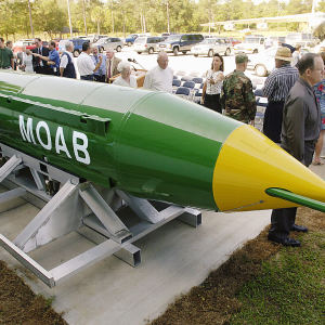 In this May 2004 photo, a group gathers around a GBU-43B, or massive ordnance air blast (MOAB) weapon, on display at the Air Force Armament Museum on Eglin Air Force Base near Valparaiso, Fla. U.S. forces in Afghanistan struck an Islamic State tunnel complex in eastern Afghanistan on Thursday, April 13, 2017, with a GBU-43B, the largest non-nuclear weapon ever used in combat by the U.S. military, Pentagon officials said. (Mark Kulaw/Northwest Florida Daily News/AP/CP)