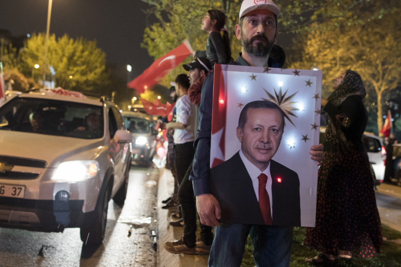 Supporters of Turkish President Recep Tayyip Erdogan celebrate his victory in a constitutional referendum. Amendments to Turkey's constitution will concentrate power in the presidency, ensuring Erdogan's dominance over Turkish politics for the foreseeable future. (Photograph by Adnan Khan)