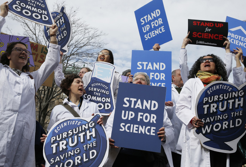 Scientists, science advocates and community members gather in Copley Square in Boston on Feb. 19, 2017 for a Rally to Stand up for Science, a call to fight against President Trumps perceived efforts to discredit science and climate research, and to dismantle scientific institutions in the government. (Jessica Rinaldi/The Boston Globe/Getty Images)
