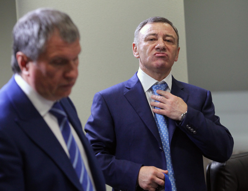 Russian businessman and billionaire Arkady Rotenberg (R) and Rosneft's oil company President Igor Sechin (L) seen during the openings of the 2013 IIHF U18 World Junior Championship on April 18, 2013 in Sochi, Russia. (Sasha Mordovets/Getty Images)