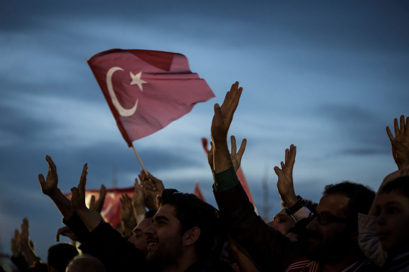 The crowd, who are celebrating the results of the referendum, listen to Turkish President Recep Tayyip Erdogan (not seen) at the Presidential Complex in Ankara, Turkey on April 17, 2017. (Binnur Ege Gurun/Anadolu Agency/Getty Images)