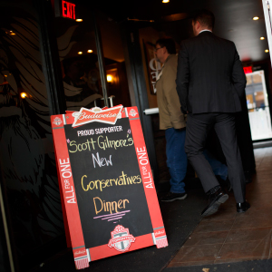 People arrive to Scott Gilmore's New Conservative's Dinner at Brazen Head Pub in Toronto, Ontario on Tuesday, April 25, 2017.   (Photo by Cole Burston)