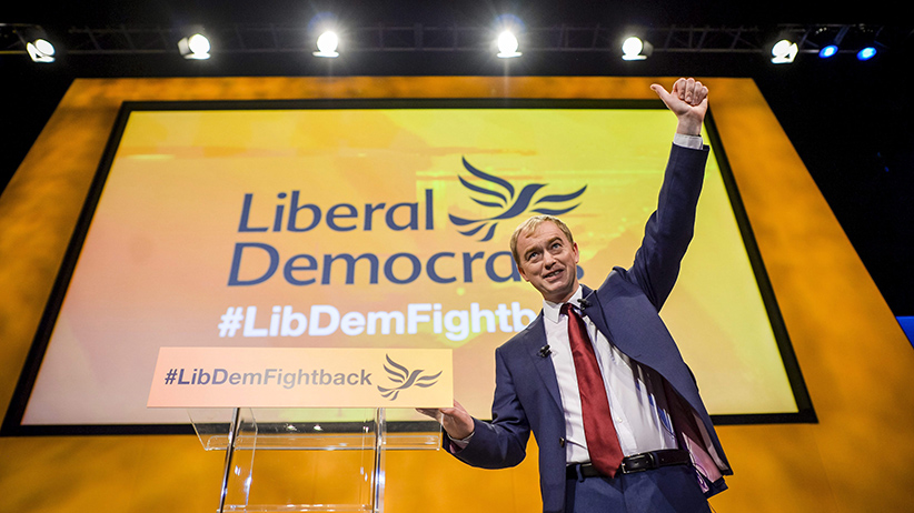 Leader of the Liberal Democrats party, Tim Farron, acknowledges the members of the audience after he delivered his keynote speech at the Liberal Democrats annual conference in the Bournemouth International Centre, southern England, Wednesday Sept. 23, 2015. Farron seized on the issue of Europe's migrant crisis, as he made his pitch to the public - and Lib Dem activists still reeling from the disastrous general election - that his party should return to government in 2020. (Ben Birchall/PA/AP/CP)