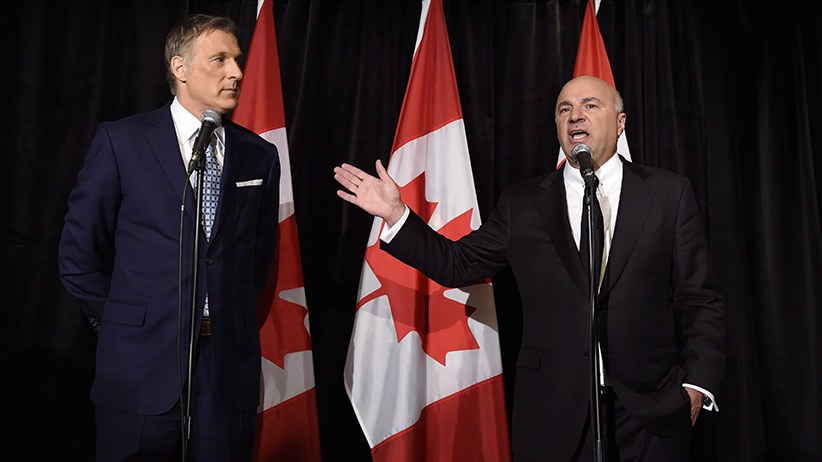 Conservative Party leadership candiidate Maxime Bernier (left) looks on as Kevin O'Leary addresses a news conference in Toronto, Wednesday, April 26, 2017, after it was announced that O'Leary had quit the leadership race and thrown his support behind Bernier. (Nathan Denette/CP)