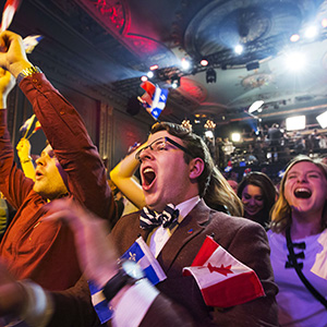 Parti Liberal Qu?b?cois (PLQ) supporters celebrate their party victory at the plaza theatre in Montreal April 7, 2014.  Canada's Quebec province voted out a separatist government Monday, choosing a former neurosurgeon and his federalist Liberal party to lead a promised economic rally.         AFP PHOTO / Fran?ois Laplante-Delagrave        (Photo credit should read Fran?ois Laplante-Delagrave/AFP/Getty Images)