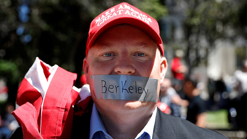A man looks on as opposing factions gather over the cancelation of conservative commentator Ann Coulter's speech at the University of California, Berkeley, in Berkeley, California, U.S., April 27, 2017. (Stephen Lam/Reuters)