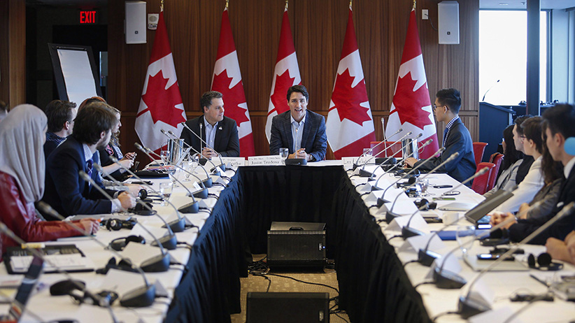 Prime Minister Justin Trudeau, centre, attends a meeting of the Prime Minister's Youth Council in Calgary on Wednesday, Jan. 25, 2017. (Jeff McIntosh/CP)