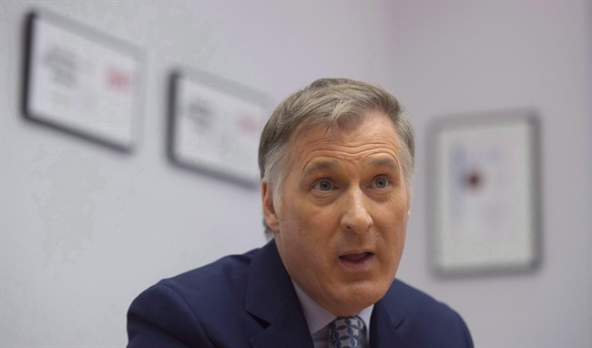 Conservative leadership candidate Maxime Bernier speaks with The Canadian Press during an interview in Ottawa, Tuesday, April 4, 2017. Bernier has welcomed U.S. Donald Trump's swipe at the Canadian dairy industry, saying that it's not just American farmers who are losing out.THE CANADIAN PRESS/Adrian Wyld
