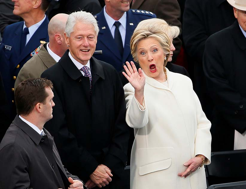 Former Secretary of State Hillary Clinton waves as she arrives with her husband former President Bill Clinton during inauguration ceremonies swearing in Donald Trump as the 45th president of the United States on the West front of the U.S. Capitol in Washington, U.S., January 20, 2017. (Rick Wilking/Reuters)