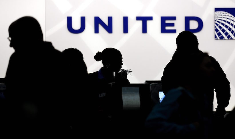 Travelers check in at the United Airlines ticket counter at Terminal 1 in O'Hare International Airport in Chicago. . (AP Photo/Nam Y. Huh, File)