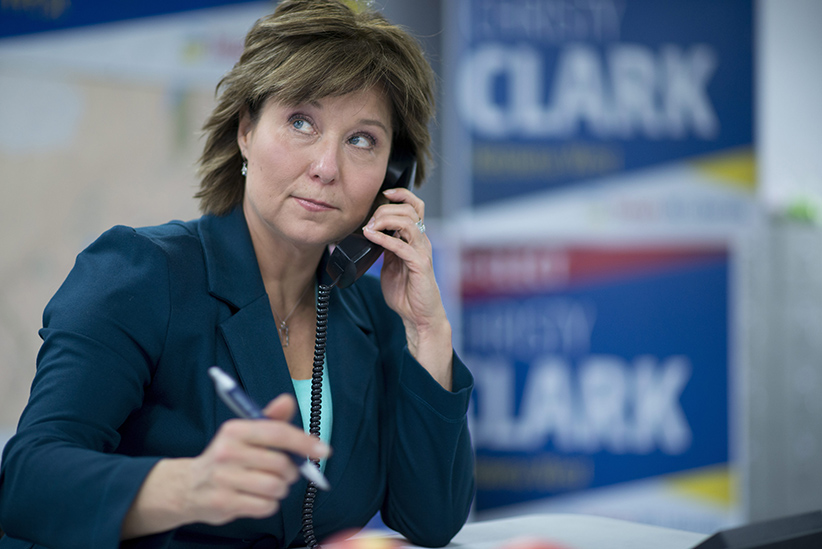 Liberal leader Christy Clark makes calls on the day of the B.C. Election 2017