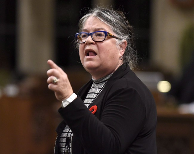 Minister of National Revenue Diane Lebouthillier rises during Question Period on Parliament Hill, Friday, Oct. 28, 2016 in Ottawa. THE CANADIAN PRESS/Justin Tang