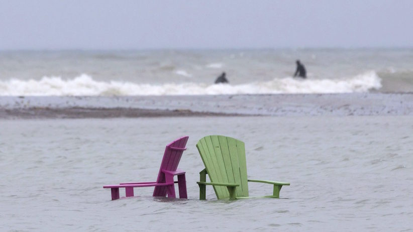 Chairs stand partially submerged on the beach at Toronto's Ashbridges Bay on Friday May 5, 2017 as continuous heavy rain causes flooding issues across the city. THE CANADIAN PRESS/Chris Young