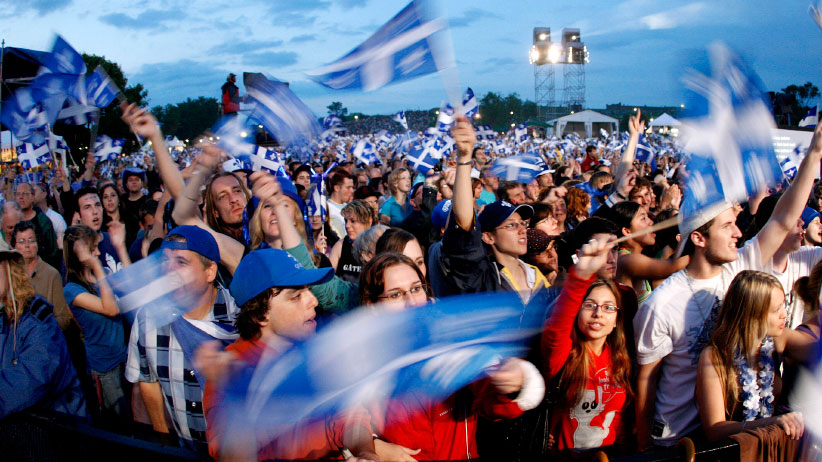 People celebrate the St-Jean Baptiste on the Plains of Abraham in Quebec City. The day is designated as a national holiday in Quebec province. (Mathieu Belanger/CP)