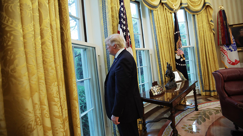 U.S. President Donald Trump looks out a window of the Oval Office following an interview with Reuters at the White House in Washington, U.S., April 27, 2017. (Carlos Barria/Reuters)