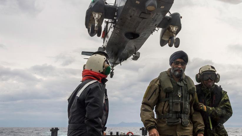 Defence Minister Harjit S. Sajjan is escorted across the flight deck of Her Majesty's Canadian Ship (HMCS) CHARLOTTETOWN as he arrives to visit the sailors during Operation REASSURANCE, December 17, 2016. Photo: Cpl Blaine Sewell, Formation Imaging Services RP10-2016-0130-025 ~ Le ministre de la Défense Harjit S. Sajjan est escorté sur le pont d'envol du Navire canadien de Sa Majesté (NCSM) CHARLOTTETOWN alors qu'il arrive pour rendre visite aux marins au cours de l'opération REASSURANCE, le 17 décembre 2016. Photo : Cpl Blaine Sewell, Services d'imagerie de la formation RP10-2016-0130-025