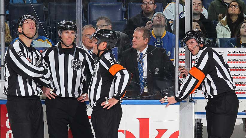 Referee Garrett Rank #48, working his first NHL game, awaits a video replay ruling during the game between the Buffalo Sabres and the Minnesota Wild on January 15, 2015 at the First Niagara Center in Buffalo, New York. (Bill Wippert/NHLI/Getty Images)