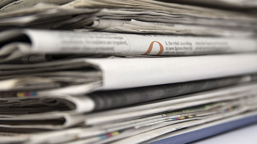 Stacked newspapers close up. (Stefan Wolny/Shutterstock)