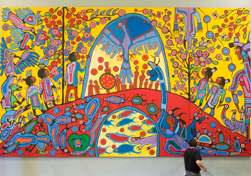 "A worker installs Canadian Aboriginal artist Norval Morrisseau's painting ""Androgyny"" in the ballroom at Rideau Hall in Ottawa on Sept. 18, 2008. The work of Toronto painter Amanda PL is infused with bright colours and bold outlines often associated with an indigenous art style. But for those steeped in the Woodland School of Art, as the genre is also known, it smacks of cultural appropriation by a young artist with no claim to the tradition. Outrage over Amanda PL's work has renewed debate over who has the right to use and profit from specific customs. Amanda PL has said her work was inspired by the Woodland school of art and acknowledged a similarity to the work of Anishinaabe artist Norval Morrisseau. (Adrian Wyld/CP)"