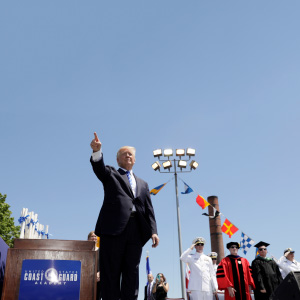 U.S. President Donald Trump points to the audience at the conclusion of the United States Coast Guard Academy Commencement Ceremony in New London, Connecticut U.S., May 17, 2017.  (Kevin Lamarque/Reuters)