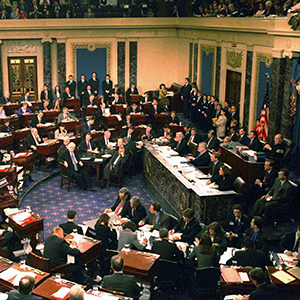 "WASHINGTON,D.C. - FEBRUARY 11: The US Senate votes in its trial against impeached US President Bill Clinton on  February 12,1999  in Capitol Hill in Washington, DC. Clinton escaped removal from office and declared himself ""profoundly sorry"" for the year-long ordeal that led to his acquittal in the Senate impeachment trial. (AFP/Getty Images)"
