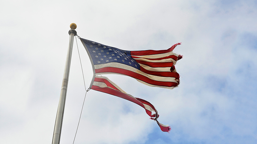 Tattered American flag flies after Hurricane Sandy. (Education Images/UIG/Getty Images)