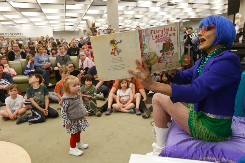 Pharaoh Moans reads to children and parents at the Millennium Library in Winnipeg Saturday, May 20, 2017. Winnipeg Public Library hosted Read by Queens, a family storytime event with stories read and performed by local drag queens on on May 20, 2017. (Photograph by John Woods)
