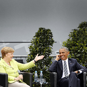 German Chancellor Angela Merkel and former U.S. President Barack Obama attend a discussion at the German Protestant Kirchentag in front of the Brandenburg Gate in Berlin, Germany, May 25, 2017. (Axel Schmidt/Reuters)