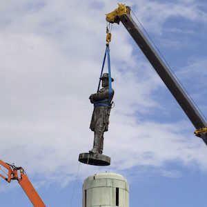 A statue of Confederate General Robert E. Lee is removed from Lee Circle Friday, May 19, 2017, in New Orleans. Lee's was the last of four monuments to Confederate-era figures to be removed under a 2015 City Council vote on a proposal by Mayor Mitch Landrieu. (AP Photo/Scott Threlkeld)