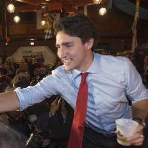 Liberal Leader Justin Trudeau serves a beer to an attendee during an Oktoberfest celebration in Kitchener, Ont., on Tuesday, October 13, 2015. THE CANADIAN PRESS/Paul Chiasson