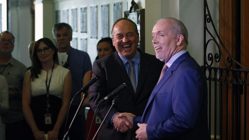 B.C. Green party leader Andrew Weaver and B.C. NDP leader John Horgan speak to media after announcing they'll be working together to help form a minority government during a press conference at Legislature in Victoria, B.C., on Monday, May 29, 2017. THE CANADIAN PRESS/Chad Hipolito