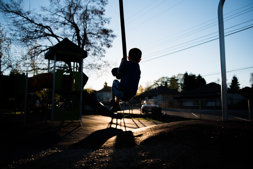 This image is of my 5 year old son Carter. I let him stay up late last week and we went out the to park at sunset. IÕm sitting on the ground crouched down with my camera aimed up at him. I wanted him to be a silhouette and had to time it perfectly with him ziplining right in front of the setting sun. The park is in Cumberland, on Vancouver Island, BC.