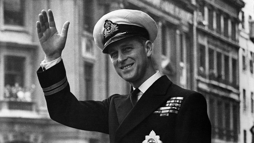 Prince Philip, Duke Of Edinburgh waving through the open roof of a car in 1948. (Central Press/Getty Images)