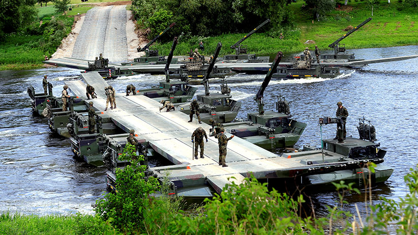 German Army soldiers dismantle a bridge over the Neris river during the 2017 Iron Wolf exercise in Stasenai, Lithuania, June 20, 2017. (Ints Kalnins/Reuters)