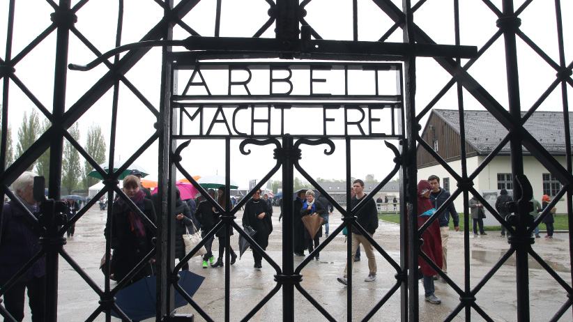 DACHAU, GERMANY - MAY 03: A general view of entrance gate of the Dachau concentration camp during a ceremony to commemorate the 70th anniversary of the liberation at the memorial site on the grounds of the former concentration camp on May 3, 2015 in Dachau, Germany. Dachau was the first Nazi concentration camp and began operation in 1933 to hold political prisoners, though it later expanded to include Jews, common criminals and foreign nationals. It served mainly as a source of slave labour during World War II and included approximately 100 sub-camps spread across southern Germany and Austria. At least 30,000 inmates died before its liberation by U.S. troops in 1945. (Photo by Alexandra Beier/Getty Images)
