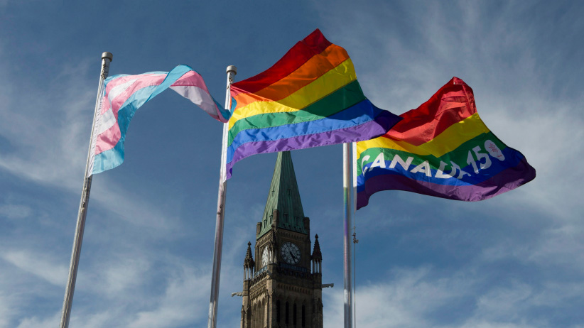 The pride and transgender flags fly on Parliament Hill following a ceremony with Prime Minister Justin Trudeau in Ottawa, Wednesday June 14, 2017. (Adrian Wyld/CP)